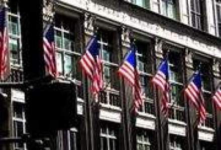 Nou val de concedieri pe Wall Street