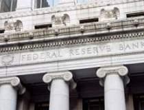 Fed reduce prognoza de...