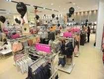 Retailerul Next a deschis un...