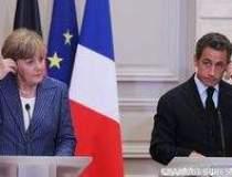 Sarkozy si Merkel vor discuta...
