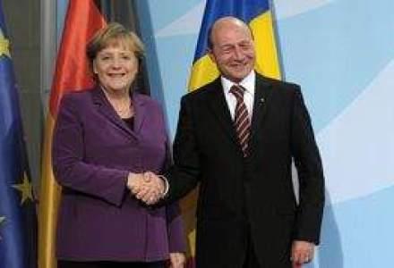 Basescu s-a dus la Berlin sa anunte marea privatizare