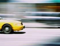Taxify reduce tarifele pana...