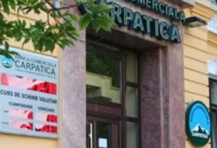 Banca Carpatica si-a redus anul trecut pierderile cu 80%
