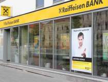 Profitul net al Raiffeisen...