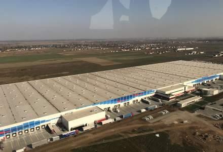 VIDEO: eMAG a deschis cel mai mare centru logistic de acest tip din Sud-Estul Europei. Are 0,6 km lungime si 3 MIL. de produse pregatite pentru Black Friday 2018