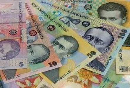 Moneda nationala s-a depreciat, intr-o piata cu lichiditate in crestere
