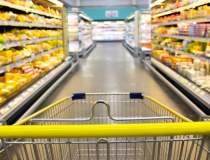Concurenta a amendat Auchan,...