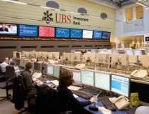 UBS va desfiinta 10.000 de...