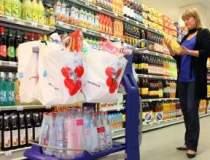 Auchan plateste 1,1 mld. euro...