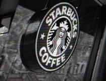 Starbucks inchide 500 de...