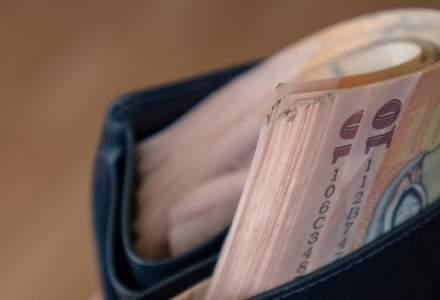 Salariul mediu net a scazut in iulie: in IT, media ajunge la 7.144 lei