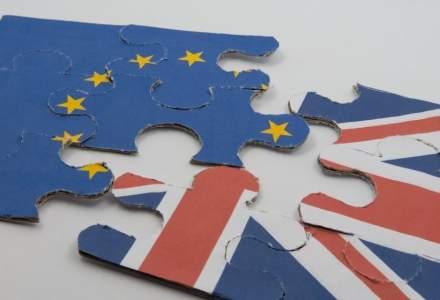 Experti: Regatul Unit trebuie sa reduca salariul minim pentru straini dupa Brexit