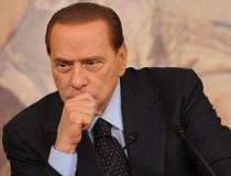 Berlusconi, condamnat la 7...