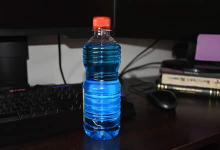 IGPR: Sticle cu lichid de parbriz ce urmau să fie vândute ca spirt, găsite de poliţişti în judeţul Prahova