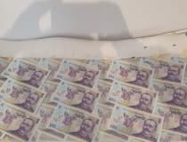 Bani falși descoperiți de...
