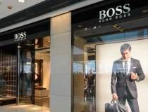 Angajații Hugo Boss vor lucra...