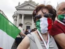 Italienii, obligaţi să poarte...