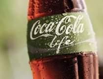 Coca-Cola reduce costurile cu...