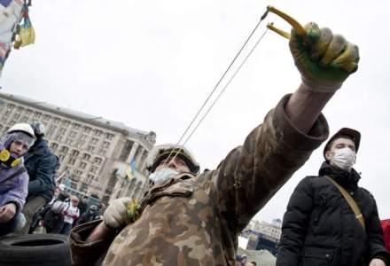 Violentele de la Kiev ii afecteaza si pe afaceristii romani: ce investitii au fost puse la naftalina