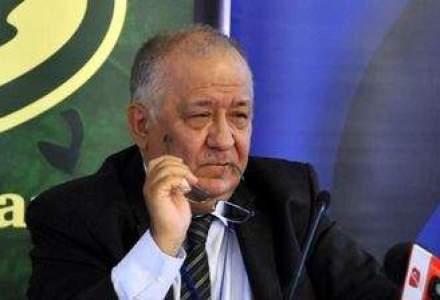 "Doua banci din Romania vor sa fuzioneze: ""2014, un an greu pentru bancheri"""