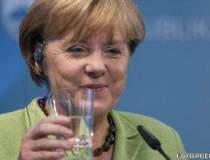 Angela Merkel, la telefon cu...