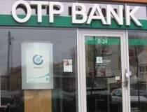 OTP Bank si-a redus...