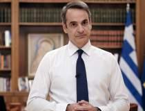 Premierul grec, criticat...