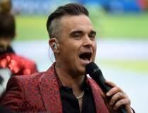 Robbie Williams vrea să...