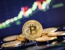 Bitcoin depășește pentru...