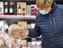 Estimări: Românii cumpără mai...