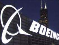 Profitul net al Boeing a...