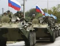 Rușii continuă manevrele de...