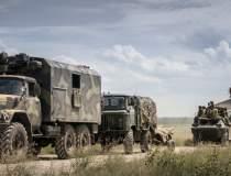 Rusia își retrage soldații de...