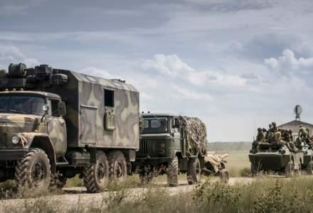 Rusia își retrage soldații de la granița cu Ucraina