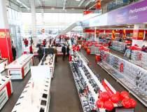 Altex deschide șase magazine...
