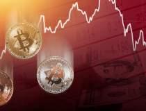 Bitcoin a căzut sub 30.000 de...
