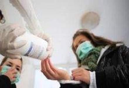 Inca doua decese provocate de gripa noua