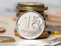 Rusia: Rubla isi revine...