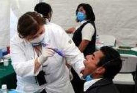 Trei decese provocate de gripa porcina in ultimele 24 de ore