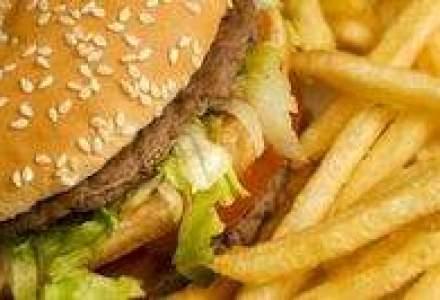 Presa internationala: Taxa pe fast-food din Romania este unicat in lume