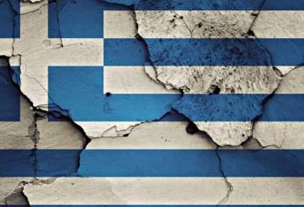 Angela Merkel incearca sa relanseze negocierile de salvare a Greciei