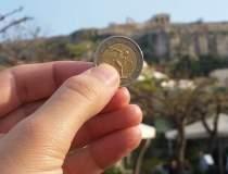 Grecia cere un plan de...