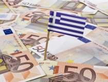 Grecia cere 53,5 miliarde de...