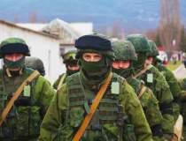 Zeci de militari rusi au...