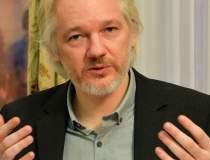 Julian Assange beneficiaza de...