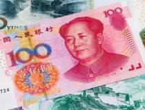 Yuanul chinezesc ar putea...