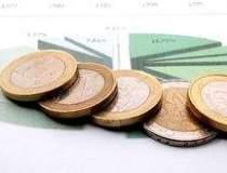 FMI: Riscul unui default de...