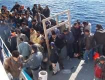 57 de imigranti, salvati de...