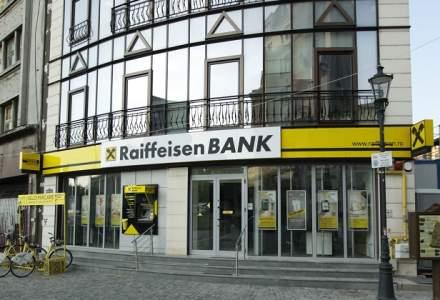 Raiffeisen Bank ajunge cu legea darii in plata la Curtea Constitutionala prin instanta din Sinaia