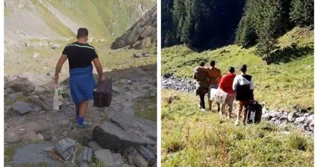 VIDEO | Drumeție pe Vf. Moldoveanu cu troler și boxă din care răsună manele. Avertismentul salvamontiștilor